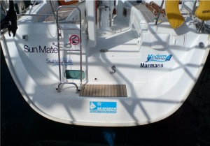 One yacht, three different company names on the back