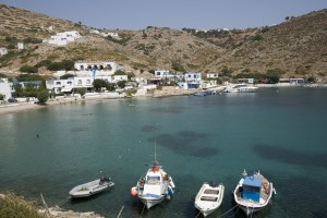 Agios Georgios: The small harbour with a motor boat on the quay
