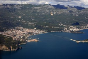 Budva: Aerial view of the town, beach and harbour with the island of St Nikola