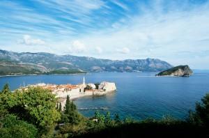 Budva: The old town fills the headland. The island of St Nikola is behind