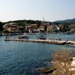 Kassiopi: The west breakwater with harbour and town behind