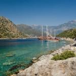 Gemiler: Boats anchored at the islands ruins