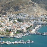 Kalymnos Town: The harbour, full of fishing boats, the masts of moored yachts in the foreground