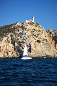Knidos: A yacht passes the lighthouse at the junction of the Aegean and Mediterranean seas