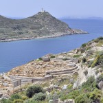 Knidos: The ruins of the Temple of Tholos with the lighthouse and Kos island behind