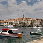 Korcula Luka: Yachts and trip boats moored in front of the town walls