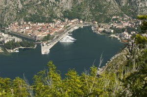 Kotor: Aerial view of the bay showing the town, port and extensive fortress walls