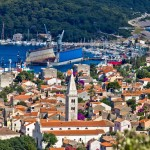 Mali Losinj: The marina by the gap in the island with the shipyard in front