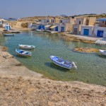 Agios Konstantinos: Fishing boats and fishermen's cottages in the creek