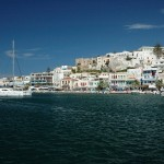 Naxos: The town with yachts moored in the harbour, overlooked by the castle centre left