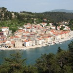 Novigrad: The village, overlooked by the 13th century Castle with local boats on the quay