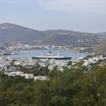 Skala Patmos: The town and harbour with a ferry in port