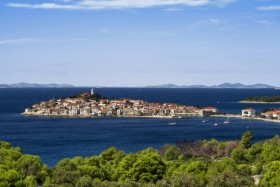 """Primosten: The walled village on the """"island"""" with yachts at anchor and in the harbour"""