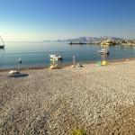Charaki: A yacht anchored off the beach