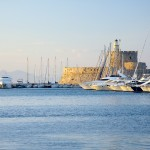 Rhodes Town: Mandraki harbour with the Fort in the background