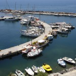 Vlychada; An assortment of boats in the marina, a cross between yacht haven and fishing harbour!
