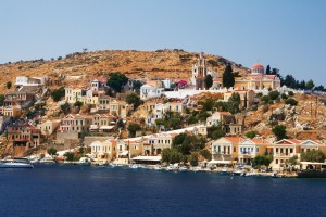 Symi Town: The north side of the harbour with local boats on the quay