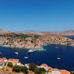 Symi Town: Aerial view of the port, with yachts moored in the inner harbour, left