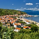 Susak: The village in its lush surroundings showing the beach and harbour