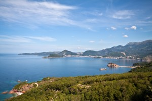 Sveti Stefan: The island with Budva in the background