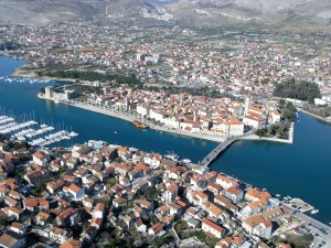 Trogir: Aerial view of the old town on the island showing the marina and long quay opposite