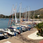 Datca: Yachts on the town quay with boats at anchor in the bay