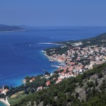 Bol: The monastery spire, bottom left, harbour, centre and Zlatni Rat in the distance