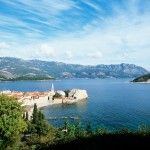 Budva: The old town fills the headland. The island of St Nikola is behind