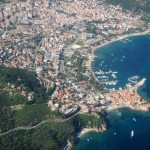 Budva: The marina next to the old town, with the beach stretching around the bay