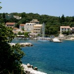 Kassiopi: The harbour entrance with yachts on the west quay