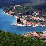 Luka: The village with yachts in the harbour and at anchor