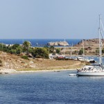 Gumusluk: The anchorage seen from the island, with yachts anchored with line ashore