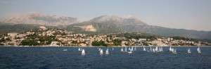 Herceg: Dinghies sailing in front of the town