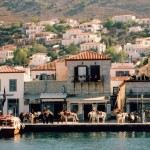 Hydra: Donkeys and water taxis in front of the restaurants and gift shops on the south quay