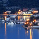 Ilovik Town: The harbour with yachts on the quays and on mooring buoys