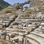 Knidos: The Roman Amphitheatre with the lighthouse visible through the arch