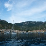 Komiza: Yachts anchored in front of the town, with St Nikola church on the hill, right
