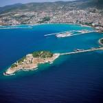 Kusadasi: Guvercin Adasi with behind, the commercial port and marina