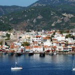 Marmaris: The harbour, unsually empty and sea front restaurants. The yachts have just left the fuel quay