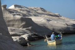 Sarakiniko: Fisherman fishing off the white rocks