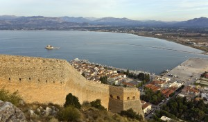 Nafplion: Wall of the Palamidi Fort with the quay and Bourtzi Fortress behind