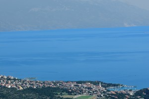 Novi Vinodolski: View over the town with Krk Island in the distance