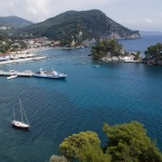 Parga, the east bay with Panayia Island and a yacht on the pier