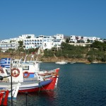 Piso Livadi: Holiday accommodation overlooks the bright red fishing boats