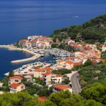 Podgora: The harbour, with modern sculpture on the hill above the town