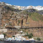 Skala Thira: The quay at the base of the cable car and steps with Fira town above
