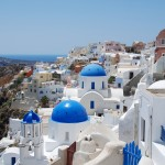 Thira: Classic view of the blue domes of Santorini
