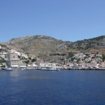 Hydra Island. The town, breakwater and harbour entrance of the port from the sea, looking south