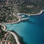 Silba: The harbour and surrounding beaches. The other side of the island is just visible.