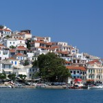 Skopelos Town: Sea front with a yacht moored on the stubby quay, right